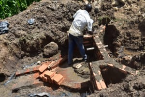 The Water Project: Ematetie Community, Amasetse Spring -  Progress On The The Walls
