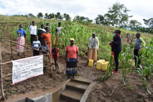 The Water Project: Ematetie Community, Amasetse Spring -  Sharing Spring Information
