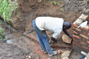 The Water Project: Ematetie Community, Amasetse Spring -  Stone Pitching