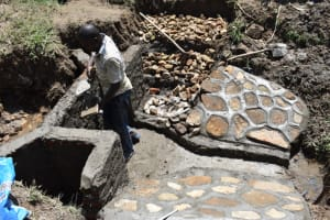 The Water Project: Ematetie Community, Amasetse Spring -  Stones Set And Finishing Plaster