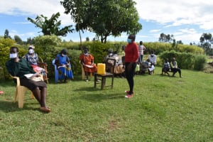 The Water Project: Ematetie Community, Amasetse Spring -  Trainer Adelide In Action