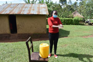 The Water Project: Ematetie Community, Amasetse Spring -  Trainer Washing Hands