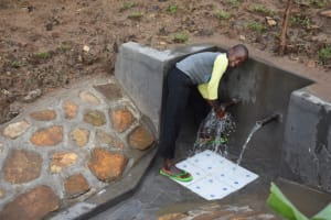 The Water Project: Ematetie Community, Amasetse Spring -  Washing Hands Before Fetching Water
