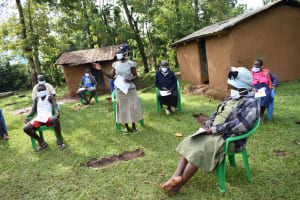The Water Project: Musango Community, Wambani Spring -  A Participant Clarifies A Point