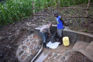 The Water Project: Musango Community, Wambani Spring -  Boys Fetching Water