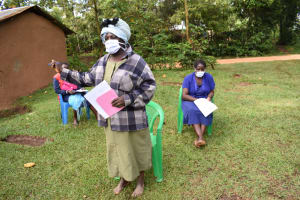 The Water Project: Musango Community, Wambani Spring -  Community Health Volunteer Encourages Others To Visit Health Facilities When Sick