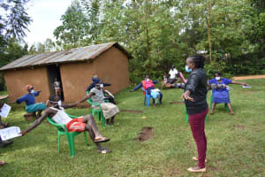The Water Project: Musango Community, Wambani Spring -  Demonstrating Physical Distancing
