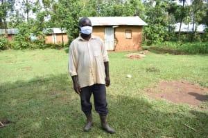 The Water Project: Musango Community, Wambani Spring -  Dishon Kutsushi Masked Up