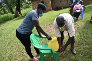 The Water Project: Musango Community, Wambani Spring -  Dishon Washes His Hands