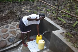 The Water Project: Musango Community, Wambani Spring -  Florence Otipa Fetches Water At The Spring