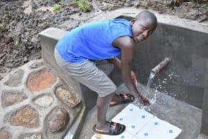 The Water Project: Musango Community, Wambani Spring -  Gabriel Enjoying The Water