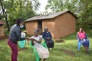 The Water Project: Musango Community, Wambani Spring -  Issuing Masks To Participants