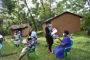 The Water Project: Musango Community, Wambani Spring -  Issuing Training Materials