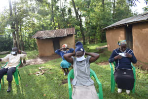The Water Project: Musango Community, Wambani Spring -  Participants Putting On Masks
