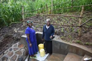 The Water Project: Musango Community, Wambani Spring -  People Collecting Water