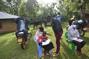 The Water Project: Musango Community, Wambani Spring -  Registration And Putting On Masks Before Beginning Training