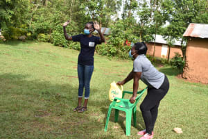 The Water Project: Musango Community, Wambani Spring -  Trainer Showing How To Wash Hands Using Soap