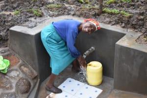 The Water Project: Musango Community, Wambani Spring -  Washing Hands Before Fetching Water