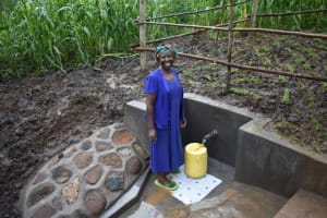 The Water Project: Musango Community, Wambani Spring -  All Smiles While Fetching Water