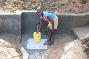 The Water Project: Ikoli Community, Odongo Spring -  Abel Fetching Water