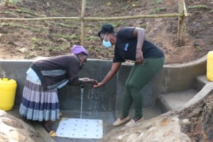 The Water Project: Ikoli Community, Odongo Spring -  Community Member Thanking Field Officer For Clean Water