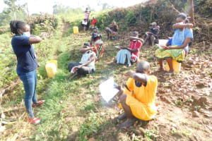The Water Project: Ikoli Community, Odongo Spring -  Demonstrating How To Cough Using Bent Elbow