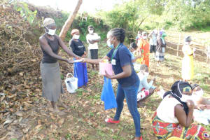 The Water Project: Ikoli Community, Odongo Spring -  Issuing Training Materials