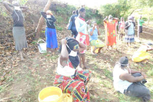 The Water Project: Ikoli Community, Odongo Spring -  Participants Putting On Masks