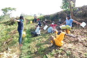 The Water Project: Ikoli Community, Odongo Spring -  Practicing A Physical Distancing Check