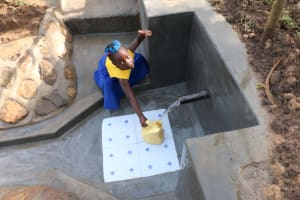 The Water Project: Ikoli Community, Odongo Spring -  Thumbs Up For Flowing Water