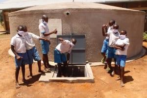 The Water Project: St. Benedict Emutetemo Primary School -  Boys Celebrating