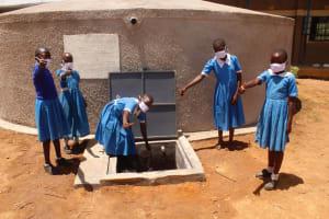 The Water Project: St. Benedict Emutetemo Primary School -  Girls Celebrating New Tank