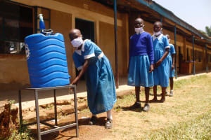 The Water Project: St. Benedict Emutetemo Primary School -  Girls Lining Up To Wash Hands