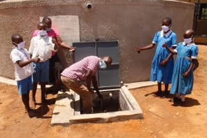 The Water Project: St. Benedict Emutetemo Primary School -  Mr Swale And Students At Tank