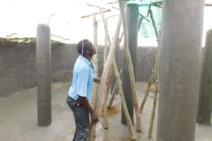 The Water Project: St. Benedict Emutetemo Primary School -  Placing Support Poles For Dome