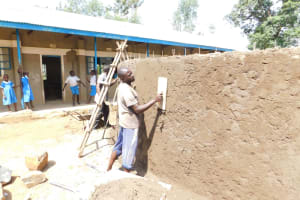 The Water Project: St. Benedict Emutetemo Primary School -  Plastering Outside Of Tank