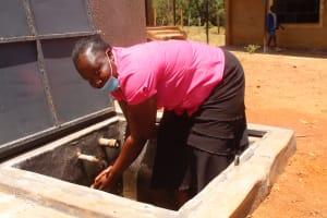 The Water Project: St. Benedict Emutetemo Primary School -  Teacher Julie Okello Washing Hands