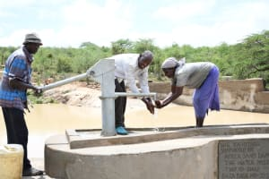 The Water Project: Lema Community A -  Getting Water From The Well