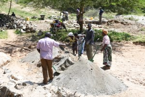 The Water Project: Lema Community A -  Mixing Cement