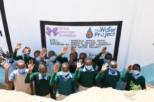 The Water Project: Mung'alu Primary School -  Students At The Tank