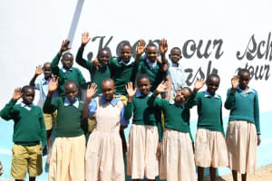The Water Project: Mung'alu Primary School -  Students At Their Water Tank