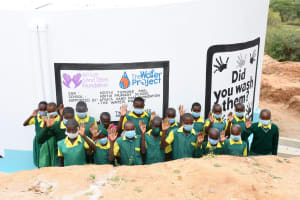 The Water Project: Ndithi Primary School -  Students At The Tank