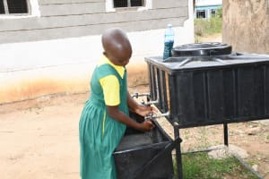 The Water Project: Ndithi Primary School -  Using The New Handwashing Station