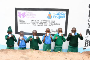 The Water Project: Kalatine Primary School -  Drinking Water From The Well