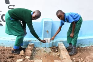 The Water Project: Kalatine Primary School -  Students Collect Water From The Tank