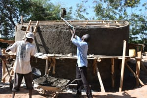The Water Project: Mukuku Mixed Secondary School -  Artisans Put Cement On The Dome