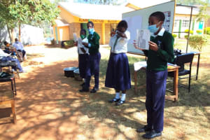 The Water Project: Mukuku Mixed Secondary School -  Students Hold Training Posters