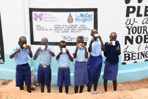 The Water Project: Mang'uu Primary School -  Drinking Water From The Tank