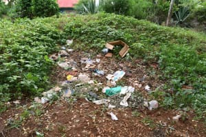 The Water Project: Migwani DEB Primary School Rain Tank -  Garbage Pit