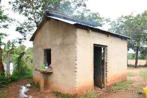 The Water Project: Migwani DEB Primary School Rain Tank -  Kitchen Building
